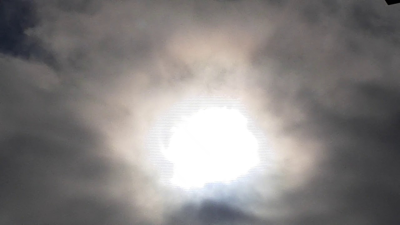 Pure White tiny Moon/Sun over Chicago Region - Look at the distortion near the image Illinois